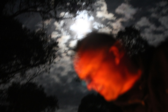 This is Anth at about 1.30am on New Year's Eve. The reflection of the fire with the full moon in the background. Creepy.